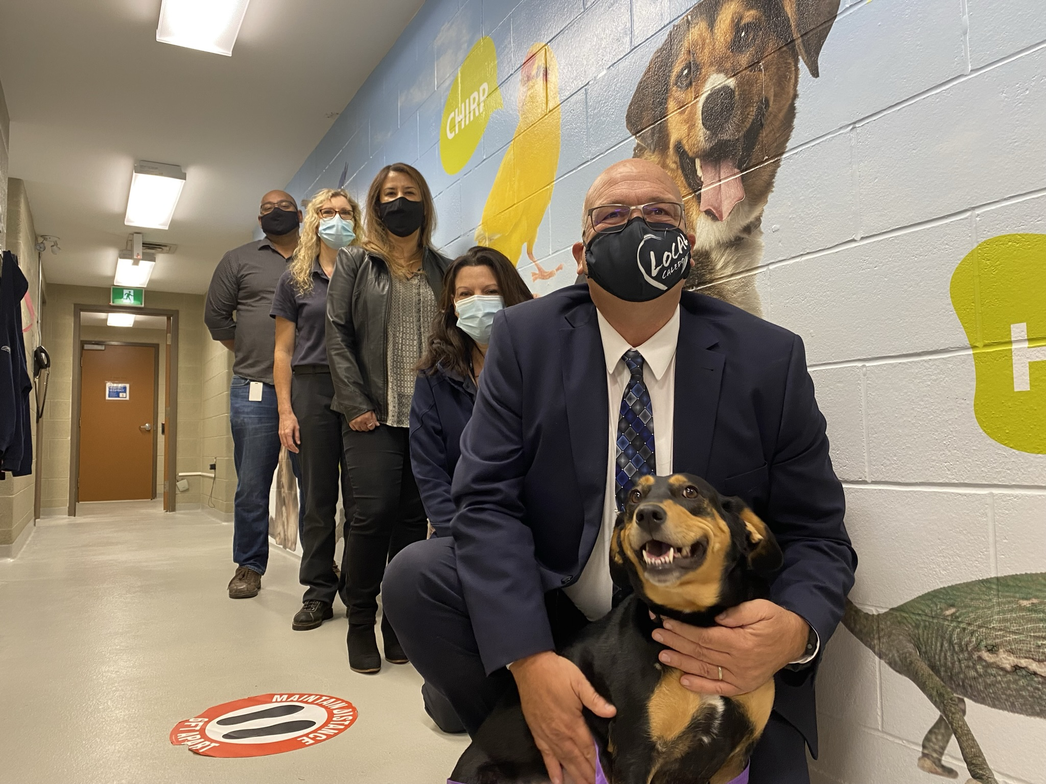 dog, Mayor and Town staff at the Animal Shelter